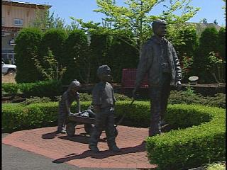 In DuPont, Wa, bronze depiction of family coming home.